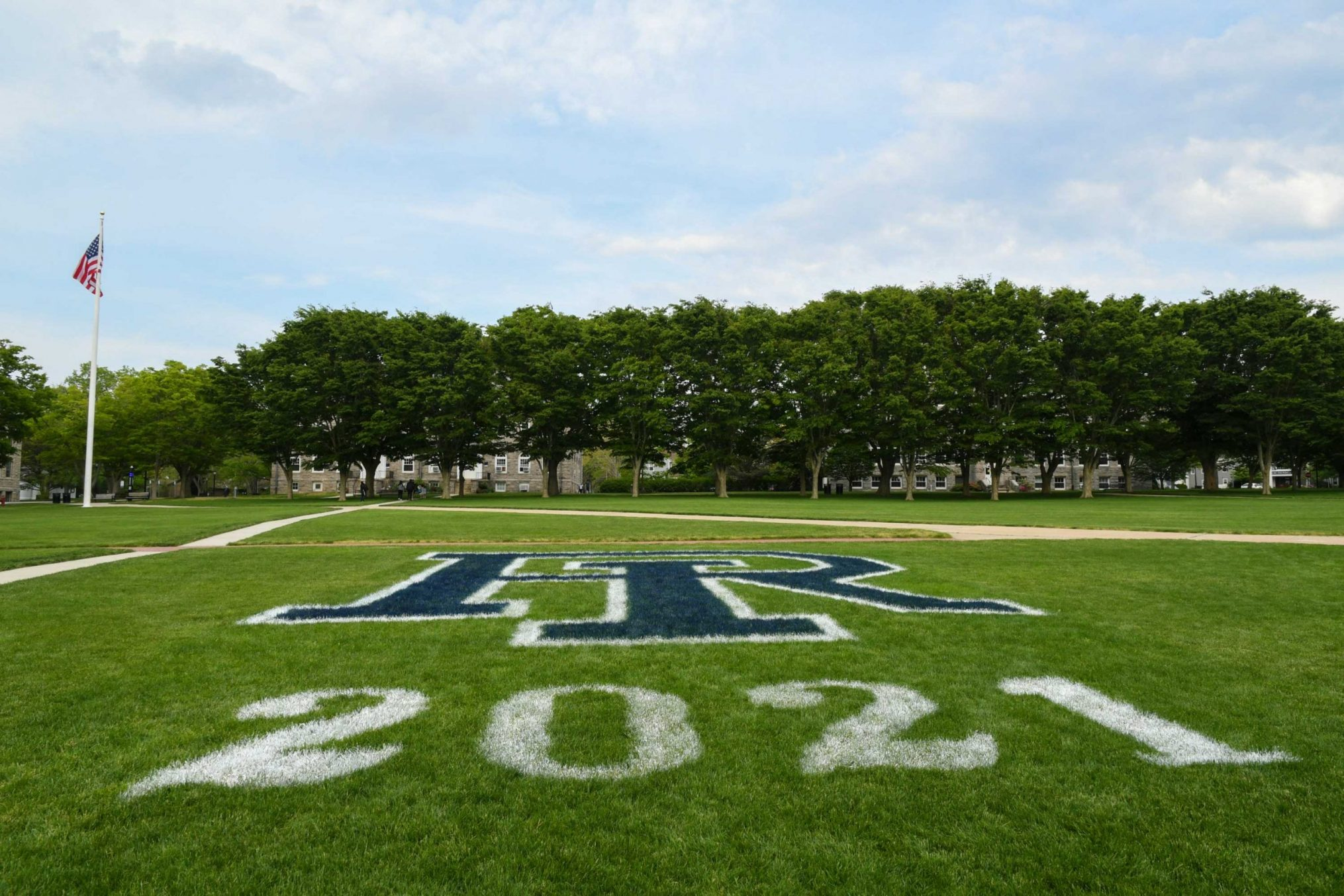 Photo of a sports field on the URI campus with the university logo.